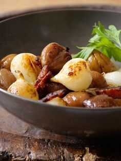 Sautéed Chestnuts, Onions, and Bacon ~ Roasted chestnuts, sautéed with pearl onions and bacon, for a festive holiday side dish. ~ SimplyRecipes.com