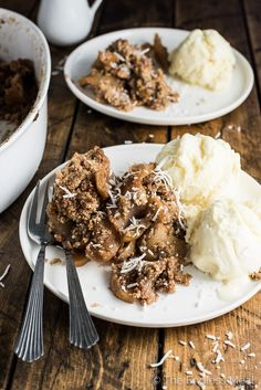 Sweet apples, topped with a coconut, pecan, and oat crumble, are baked ...