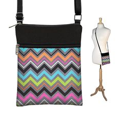 Small Sling Bag aka Passport Purse in in Cherise Chevron, an exclusive Janine King Design. Gorgeous colors. Awesome little shoulder purse that's perfect for everyday and for travel too. Its the ideal size when you want to carry the essentials. Small but not too small. The extra zipper compartment in front is perfect for cell phone, iPod, camera and/or passport when traveling. Main compartment easily accommodates wallet and checkbook. Nice long adjustable shoulder strap allows you to wear...