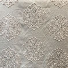 Embroidered, polyester/linen blend in light beige. Wonderful for bedding & draperies!