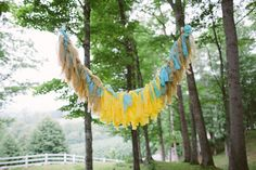 Tissue Paper Garland Backdrop Whimsical Mountain Cabin Wedding North Carolina http://www.revivalphotography.com/