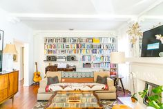 This amazing bookshelf was built by Rakks; the couple painted the shelving white to match the already coated white hardware.