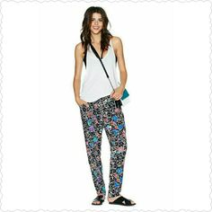 NWOT Nasty Gal maze out pants We're into minimal outfits these days, but that doesn't mean we're EVER giving up prints. These pants feature a stretch band at waist, an abstract floral print, and a loose fit. Unlined. Wear them with a crop top and a moto jacket for the perfect day-to-night look! By Nasty Gal. Nasty Gal Pants
