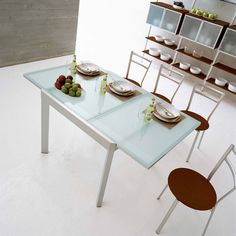 "Satin Finished Steel frame  Tempered Frosted Glass  Table seats up to six when closed and ten when extended  Extends from 51.25"" - 90.63"""