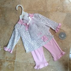 Baby Girl PJ Set with Hat New! Adorable Baby girl cheetah print outfit includes hat, long sleeve top & ruffle pants with heart on butt. 6 months. 💕                                                                  📦Same/Next Day Shipping!                                 🎀I have more Baby Girl clothes listed 0-9months! Check out my closet! 💕 Pajamas Pajama Sets