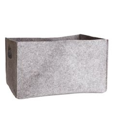 Rectangular storage basket in felt with handles at short sides. Size 9 1/4 x 12 1/4 x 17 in.