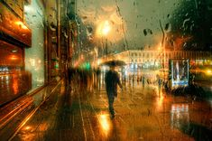 St. Petersburg-based Russian photographer Eduard Gordeev captures delicate cityscape scenes by taking photos through rainy windowpanes and glass. Flowing rain drops blur the colors and diffuse light, resulting in photos that have a strong resemblance to Impressionist oil paintings.