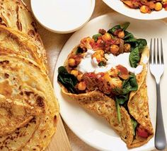 Spinach, cauliflower, and chickpea crepes with yogurt sauce
