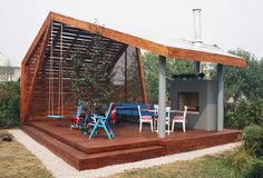 Modern Outdoor Pavilion with Fireplace and Ping-pong Table at bottom of garden...