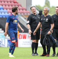 Manager Jose Mourinho of Manchester United congratulates Juan Mata after the preseason friendly match between Wigan Athletic and Manchester United at...