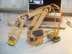 [jjshortcut] has created an easy to make robot armthat has 6degrees of freedom. There is not much to it, the frame is made out of 4mm thick hardboard, hobby servos provide the power and a handful ...