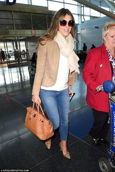 Heading home:Elizabeth Hurley, 50, showed off her effortless jet-set style as she strutted through JFK airport in New York on Friday
