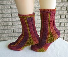 Ravelry: Perpendicular Socks pattern by Anne Campbell.  From a book of sock patterns, not free
