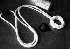 """A paracord necklace that holds guitar picks, really cool! There's a great """"how to"""" blog by Stormdrane with this and lots of other paracord crafts"""
