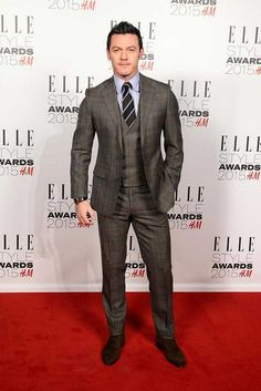 Luke Evans wears a Thom Sweeney suit and George Cleverley shoes at the ELLE Style Awards, London, February 2015.