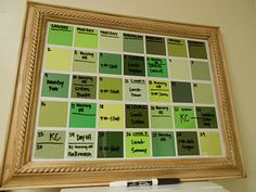 Paint chips behind a frame = dry erase calendar.  If we got larger paint swatches in the same color scheme and a really awesome frame, I think this could be a really great dry erase calendar!