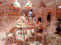 """Yayoi Kusama """"The Obliteration Room"""" Painted an entire 'interior' white and then let loose children with colored stickers"""