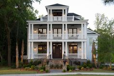 Cottage style single story home exterior french country for Charleston style house plans side porch