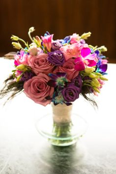 Peacock & jewel tone bouquet by Garden Blossoms.  Indian fusion wedding.  Photo by Tricia McCormack.