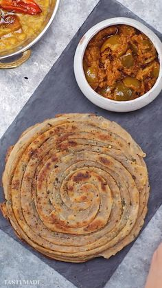 Laccha Paratha is a multi-layered shallow fried North Indian flatbread and the perfect side dish to your favourite curried food! the food recipes Indian Dessert Recipes, Indian Snacks, Dinner Recipes, Indian Breads, Indian Dishes, Indian Vegetarian Recipes, Indian Eggplant Recipes, Indian Bread Recipes, Bosnian Recipes