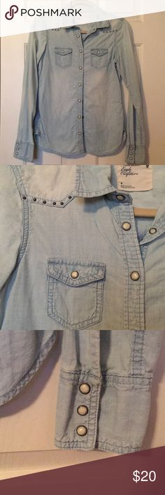 Studded chambray denim shirt This Chambray Denim shirt has a pearl snap and studded detail. Size 4 but fits more like a size 2. Light blue. Slightly worn condition. American Eagle Outfitters Tops Button Down Shirts