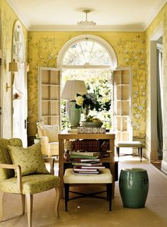 Yellow Gracie walls, mint green lamp and garden stool, books, french doors - perfect sunroom for reading - Barbara Barry