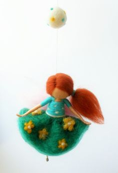 Needle felted fairy with green flowery skirt and dotted shirt, waldorf inspired by Freyjafairies on Etsy https://www.etsy.com/listing/246263650/needle-felted-fairy-with-green-flowery
