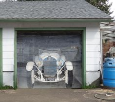 As the license plate indicates, Eric Starmer painted his dream car, a 928 Mercedes SSK roadster, in 1985 on his Seattle garage door.
