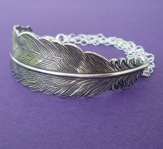 silver feather bracelet cuff sterling silver chain. $28.00, via Etsy.