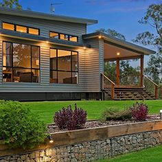 Linea weatherboards provide a classic Queensland look to this new home. Find out more in our detailed case study on this renovation by… Exterior Wall Cladding, House Cladding, Facade House, Metal Cladding, Metal Building Homes, Building A House, Building Ideas, Metal Homes, Exterior House Colors