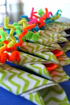Love these colorful, funky table settings for a boy's birthday party. All you need is pipe cleaners and napkins.