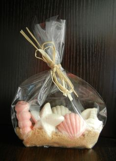 Unique Chocolate Seashell Favors - Beach Wedding - Out of Town Bags - Bridal Shower. $3.49, via Etsy.