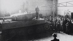 Original photos of Michael Wittmann giving a speech while standing on a Tiger Tank at the Henschel factory where Tiger tanks were made, 1943.