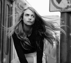 Cara Delevinge is all over the place -- frmo beauty shots to peace signs, who can keep them all straight?