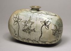 Joseon Buncheong Ware: Between Celadon and Porcelain: Bottle in the shape of a Rice Bale, Joseon dynasty (1392–1910), 15th–16th century  Korea  Stoneware with iron-brown decoration of bird, fish, and lotus under buncheong glaze; h. 6 1/8 in. (15.5 cm)  The Museum of Oriental Ceramics, Osaka