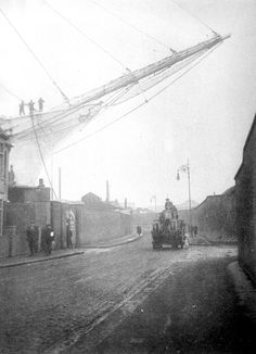 The ghostly bowsprit of a mighty sailing ship projects over the wall of Union Wharf Lower Dock in the East End. London History, British History, Vintage London, Old London, East London, Old Pictures, Old Photos, Liverpool Docks, Old Sailing Ships