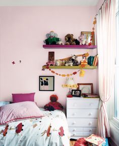 Pretty pink hues for the little one's space. | http://domino.com