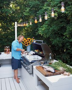 The grill area is lit from above with vintage-style bistro lights.