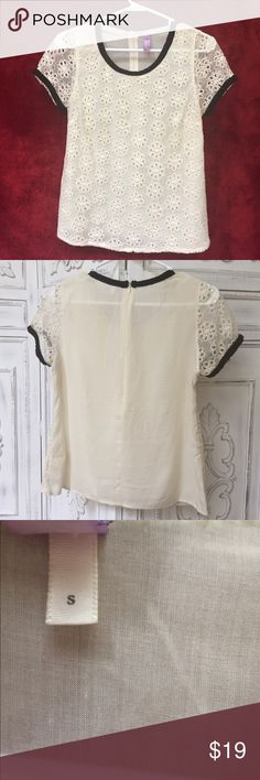 Cream Eyelet Blouse with Black Trim Size small. Great condition! Recently dry cleaned (see tag in the photo). Short sleeve. Zipper on the back. Brand is Alya from Francesca's Francesca's Collections Tops Blouses