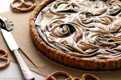 Sweet and Salty Pretzel Tart Crust with Ganache Filling and Creamy Peanut Butter Swirl