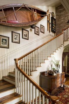For the canoe, that spot proved to be the house's expansive front staircase, where the statement-making boat resides alongside vintage skis and black-and-white photos of Curt's then-newlywed parents on a camping trip.