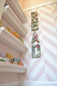 rain gutter bookshelves...perfect for tight spaces