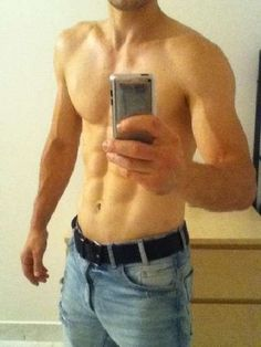 Jarek Ostrava of the Czech Republic shirtless in his bluejeans takes a mirror selfie of his 6packed torso