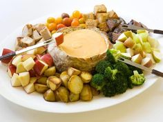 Cheddar Cheese Fondue...ooh, very cool presentation in the bread bowl!