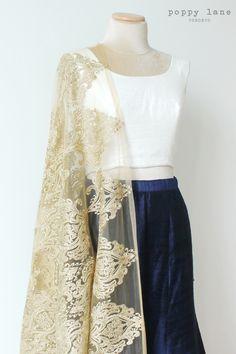 Elegant Raw Silk Navy Blue Skirt with Raw Silk White Sleeveless Blouse. Shop now at poppylane.ca
