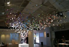 suspended acrylic balls decorated the ceiling of an exhibition titled Any Tokyo as part of an installation by architect Emmanuelle Moureaux ...