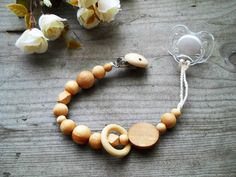 Wooden pacifier clip natural eco friendly beads wood teething toy ring teether Handmade Pacifier Clip wooden dummy chain pacifier holder by Bubuline on Etsy https://www.etsy.com/ca/listing/235783257/wooden-pacifier-clip-natural-eco