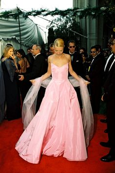 50 Amazing Oscar Looks We're Still Obsessed With #refinery29  http://www.refinery29.com/2015/02/82170/best-oscar-red-carpet-photos#slide-18  Gwyneth Paltrow, 1999  Gwyneth's pink Ralph Lauren was perfectly princessy.