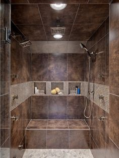 Amazing shower with fixed and hand-held shower heads, as well as a rain shower head and steam unit