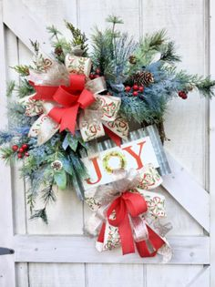 🌲 This JOY Christmas Wreath for Front Door is bursting with lots of textured greenery . Everything is tucked between large red bows. The finishing touch is the farmhouse style JOY sign that adds so much trendy style to the wreath Outdoor Christmas Wreaths, Outside Christmas Decorations, Diy Christmas Garland, Christmas Wreaths For Front Door, Christmas Signs, Holiday Wreaths, Outdoor Decorations, Red Bows, Mothers Day Wreath